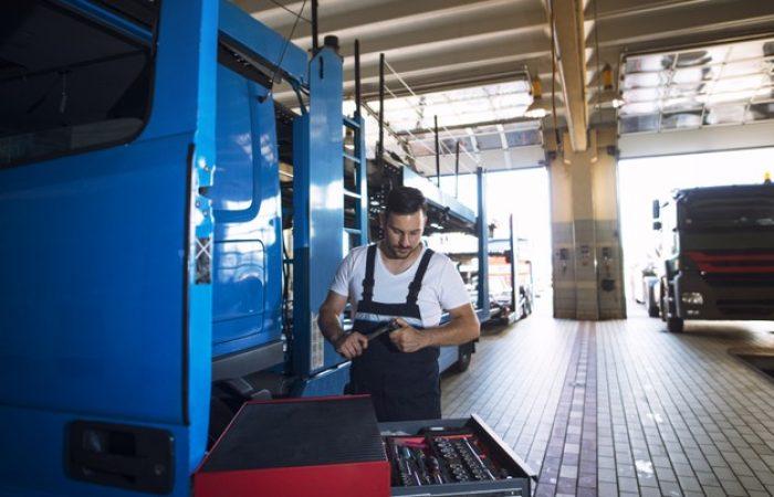 truck-mechanic-servicing-truck-vehicle-workshop_342744-1327